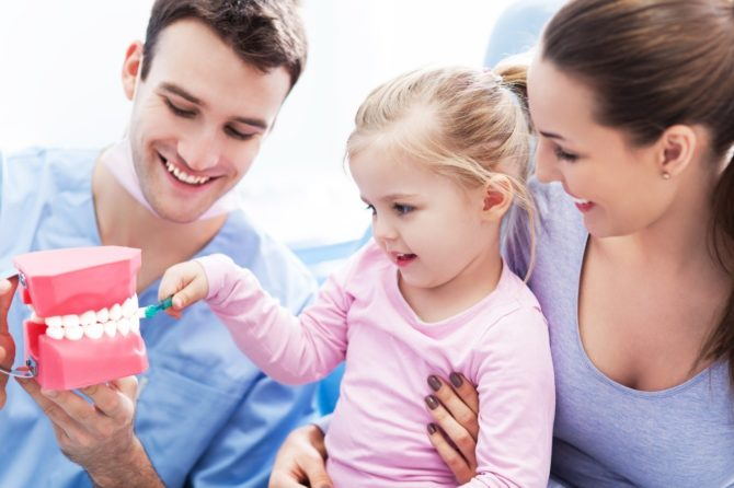 When to take the child for first oral examination???